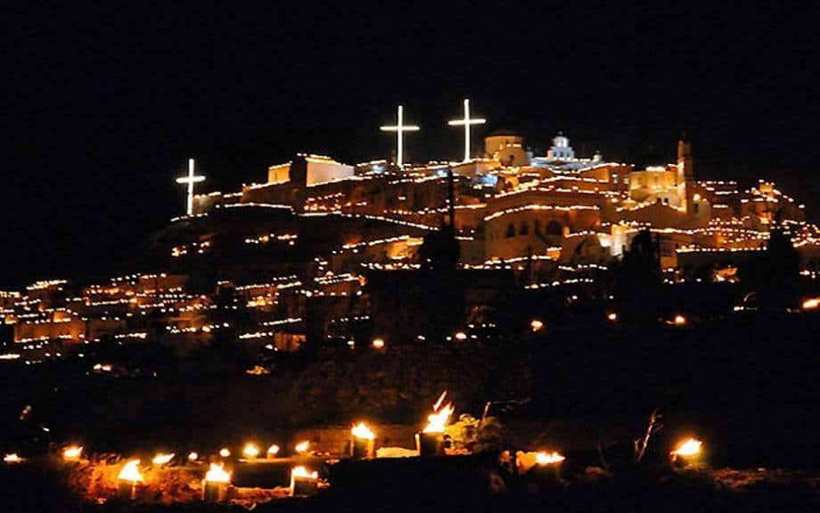 Epitafios in Pyrgos village, Santorini. The hillside is lit up with burning fire brands.