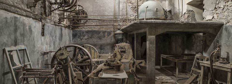 Exhibition with photographs of the lost and the remaining signs of the industrial tomato in Santorini